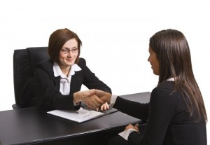 Businesswomen shaking hands in the office.The documents are mine.